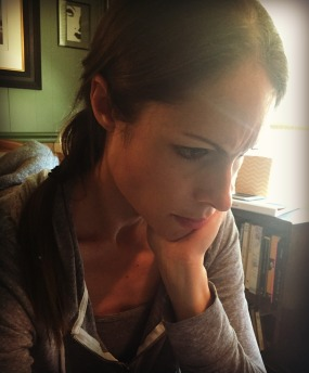 Color photograph of Malin James scowling happily in concentration for Return of the Prodigal Writer Person post