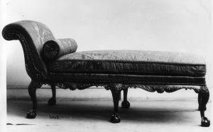 Black and white historical photograph of a 19th century chaise lounge for Flash Fiction: Grounded by Malin James